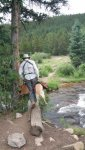 Scott Portaging Dogs Across Scott Gomer Creek 1.jpg